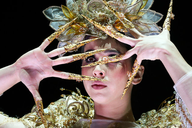 """""""Shine"""" by Alina Garcia of Macao is modelled in the Reflective Surfaces Section during the World of WearableArt Opening Night 2018 at TSB Bank Arena on September 27, 2018 in Wellington, New Zealand. (Photo by Hagen Hopkins/Getty Images for World of Wearable Art)"""