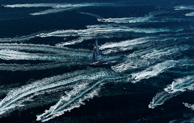The Spirit of Portopiccolo sailboat leads during the Barcolana regatta in front of the Trieste harbour, Italy October 14, 2018. (Photo by Alessandro Garofalo/Reuters)