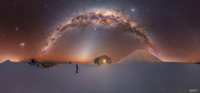 """Mount Taranaki Milky Way; Fanthams Peak, Mount Taranaki, New Zealand. """"This is one of the most challenging shots I have ever captured, as it required climbing for four hours in 70km/h winds to reach the ice summit of Fanthams Peak – a volcano on the side of Mount Taranaki. At an elevation of 2000 metres and -15C outside with gusty wind blasts, I had to choose settings that would get me the capture rather than what I may have considered more ideal settings. I am so stoked to have captured what I did under perfect clear skies, as it was both a true test of both mountaineering and endurance carrying all my gear to this location, but one I will look back on with pride and success"""". (Photo by Larryn Rae/Milky Way Photographer of the Year)"""