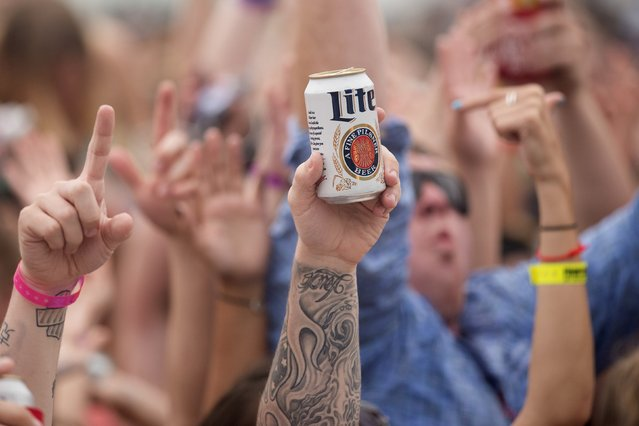 People cheer at a beach concert during spring break festivities in Panama City Beach, Florida March 12, 2015. Unwilling to evict spring break, a crucial season in a community where tourism brings in more than $1 billion annually, the city has passed new rules to counter the worst excesses. Bars must stop serving alcohol at 2 a.m. in March, two hours earlier than before. (Photo by Michael Spooneybarger/Reuters)