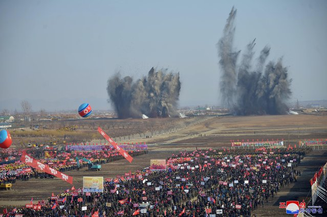 In this picture taken on March 23, 2021 and released from North Korea's official Korean Central News Agency (KCNA) on March 24, 2021 people attend ground-breaking ceremony of a construction project for building 10000 apartments in Pyongyang. (Photo by KCNA via KNS/AFP Photo)