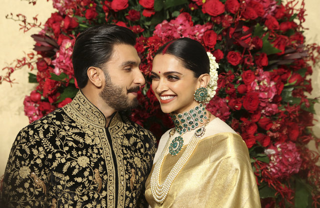 Bollywood actors Deepika Padukone, right, and Ranveer Singh pose at their wedding reception in Bangalore, India, Wednesday, November 21, 2018. The couple got married at Villa Balbianello, a lakeside mansion featured in Star Wars and James Bond films in Lenno, Como lake, northern Italy on Nov. 14, 2018. (Photo by Aijaz Rahi/AP Photo)