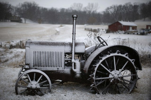 A snow covered tractor is seen near Mt. Vernon, Iowa, January 25, 2015. 2015. (Photo by Jim Young/Reuters)