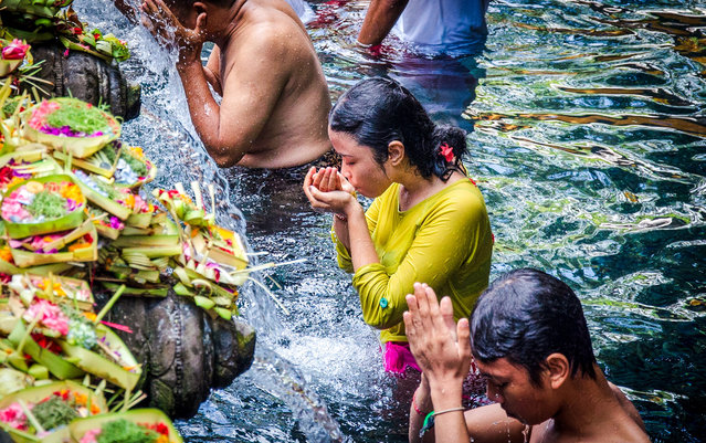 """""""Worshippers at the 11th-century Gunung Kawi Hindu temple in Bali, Indonesia"""". (Photo by Adela Voicu/The Guardian)"""