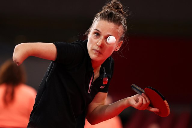 Poland's Natalia Partyka serves to Australia's Michelle Bromley during their women's singles round 1 table tennis match at the Tokyo Metropolitan Gymnasium during the Tokyo 2020 Olympic Games in Tokyo on July 24, 2021. (Photo by Thomas Peter/Reuters)