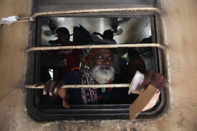 A fisherman from India looks out of a train window, after his release with others from a prison, at Karachi's Cantonment railway station, February 15, 2015. According to local media, Pakistani authorities released 172 Indian fishermen who were detained for illegally venturing into Pakistani waters, as a good will gesture and part of cricket diplomacy on Sunday. (Photo by Akhtar Soomro/Reuters)