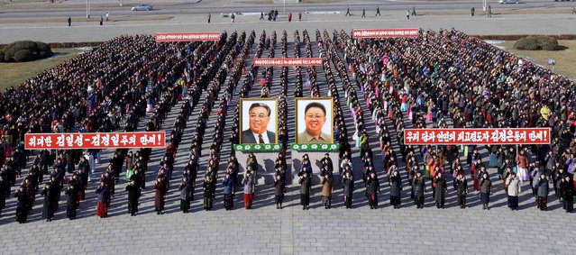 People take part in mass rallies held across the country vowing to carry out tasks set forth by North Korean leader Kim Jong Un in this undated photo released by North Korea's Korean Central News Agency (KCNA) in Pyongyang on January 8, 2016. (Photo by Reuters/KCNA)