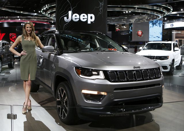 Model Victoria Sary poses with a 2017 Jeep Compass during the North American International Auto Show in Detroit, Michigan, U.S., January 10, 2017. (Photo by Rebecca Cook/Reuters)