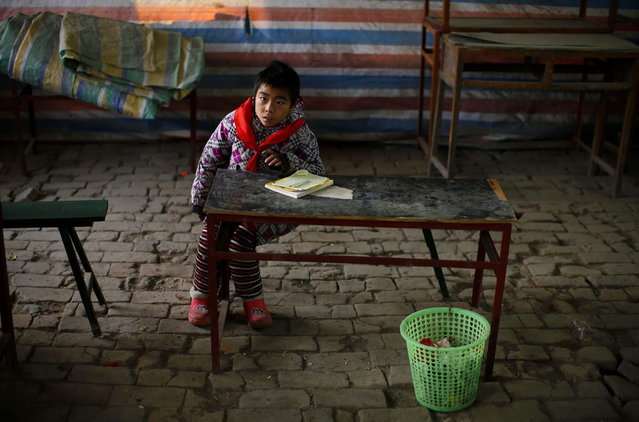 A student attends a class at the Democracy Elementary and Middle School in Sitong town, Henan province December 3, 2013. (Photo by Carlos Barria/Reuters)