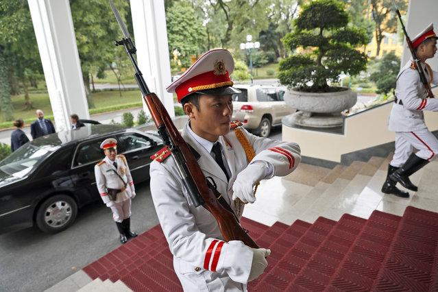 An honor guard is seen outside a meeting of U.S. Secretary of State John Kerry and Vietnamese Prime Minister Nguyen Xuan Phucat the Office of the Government, Friday, January 13, 2017 in Hanoi, Vietnam. (Photo by Alex Brandon/AP Photo)
