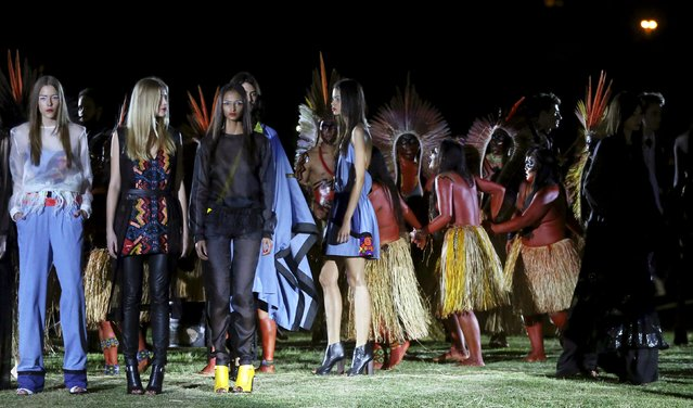 Models present creations from the Cavalera Summer 2016 Ready To Wear collection with indians of Yawanawa ethnicity during Sao Paulo Fashion Week in Sao Paulo April 13, 2015. (Photo by Paulo Whitaker/Reuters)