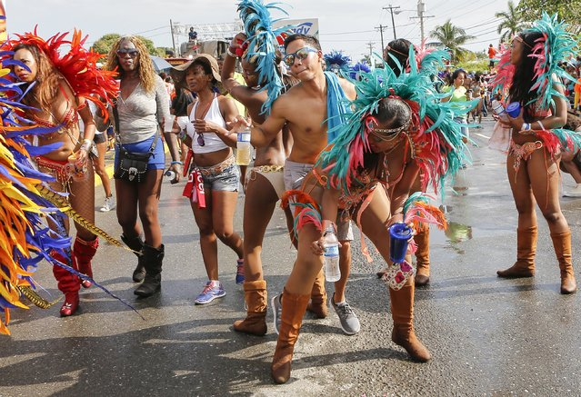 Revelers dance on a street during the Jamaica Carnival Road march in Kingston April 12, 2015. The march is on the final day of festivities of the Carnival season. (Photo by Gilbert Bellamy/Reuters)