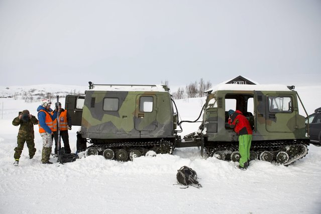 Rescuers stand beside a search and rescue snowcat in Grotli, Norway, February 26, 2016. Thirteen Dutchmen who were stranded while hiking in central Norway's mountains were found after snowmobile patrols by the Red Cross. Snowcats from the Red Cross are now moving ahead to pick the hikers up. (Photo by Torstein Boe/Reuters/NTB Scanpix)