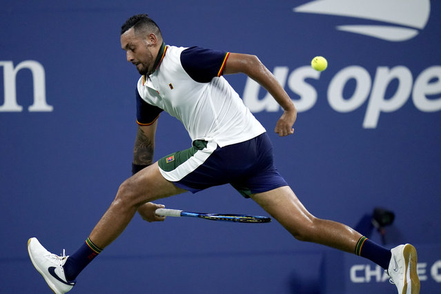 Nick Kyrgios, of Australia, returns a shot between his legs against Roberto Bautista Agut, of Spain, during the first round of the US Open tennis championships, Monday, August 30, 2021, in New York. (Photo by Frank Franklin II/AP Photo)