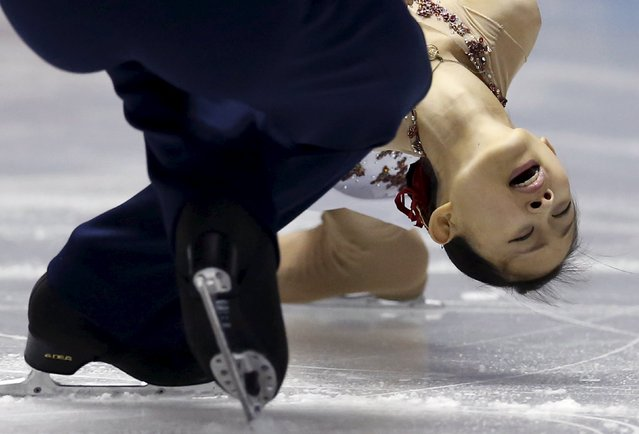 Ami Koga and Francis Boudreau Audet of Japan compete during the pairs short program at the ISU World Team Trophy in Figure Skating in Tokyo April 17, 2015. (Photo by Yuya Shino/Reuters)