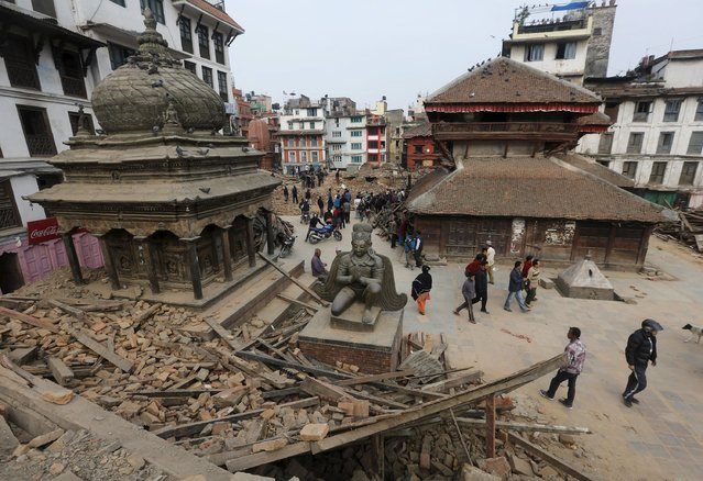 People walk past the rubble of a temple destroyed in Saturday's earthquake, in Kathmandu, Nepal April 28, 2015. (Photo by Adnan Abidi/Reuters)
