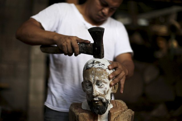 Jose Sabas Gomez's son Miguel Sabas works on a statue of El Jesus Nazareno in his workshop in Apastepeque, El Salvador March 9, 2016. Jose Sabas Gomez is one of a small number of artists still working on traditional religious art in El Salvador. According to him, there used to be more workshops engaged in the work of restoring statues of saints, but only four remain today as the labor-intensive craft is no longer a popular choice of profession. (Photo by Jose Cabezas/Reuters)