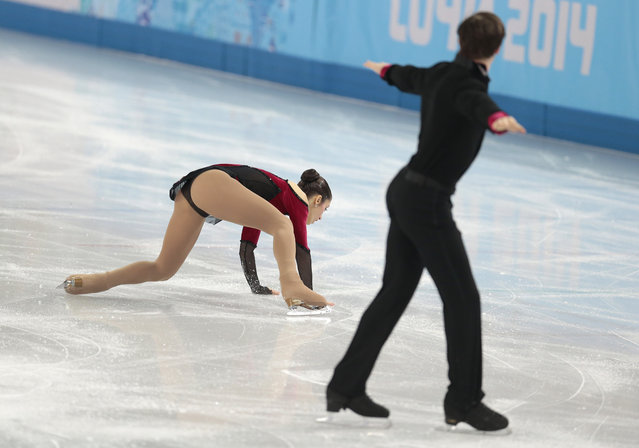 Stefania Berton falls as she and Ondrej Hotarek of Italy compete in the team pairs free skate figure skating competition at the Iceberg Skating Palace during the 2014 Winter Olympics, Saturday, February 8, 2014, in Sochi, Russia. (Photo by Ivan Sekretarev/AP Photo)