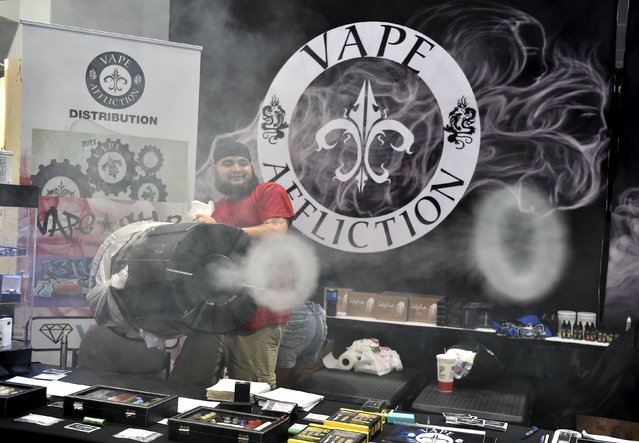 Bodie Hultz with Vape Affliction, uses a trash can to create rings of vapor at the Vape Summit 3 in Las Vegas, Nevada May 2, 2015. (Photo by David Becker/Reuters)