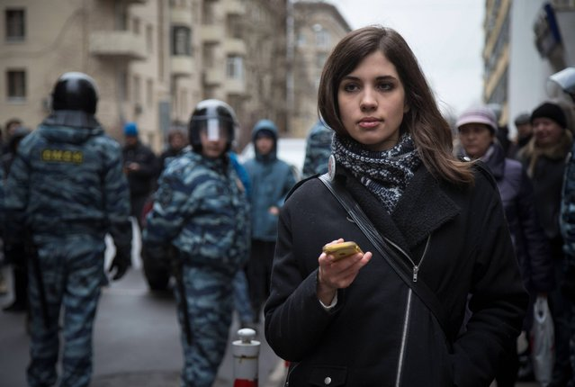 Member of the p*ssy Riot punk group, Nadezhda Tolokonnikova stands outside Zamoskvoretsky District Court in Moscow, Russia, Monday, February 24, 2014, where hearings started against opposition activists detained on May 6, 2012 during the rally at Bolotnaya Square. (Photo by Alexander Zemlianichenko/AP Photo)
