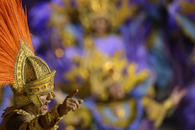 A performer from the Salgueiro samba school parades on a float during carnival celebrations at the Sambadrome in Rio de Janeiro, Brazil, Monday, March 3, 2014. (Photo by Felipe Dana/AP Photo)
