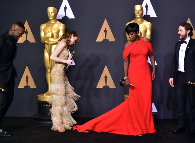 Best Supporting Actor Mahershala Ali, Best Actress Emma Stone, Best Supporting Actress Viola Dvis and Best Actor Casey Affleck pose in the press room during the 89th Annual Academy Awards on February 26, 2017, in Hollywood, California. (Photo by Frederic J. Brown/AFP Photo)