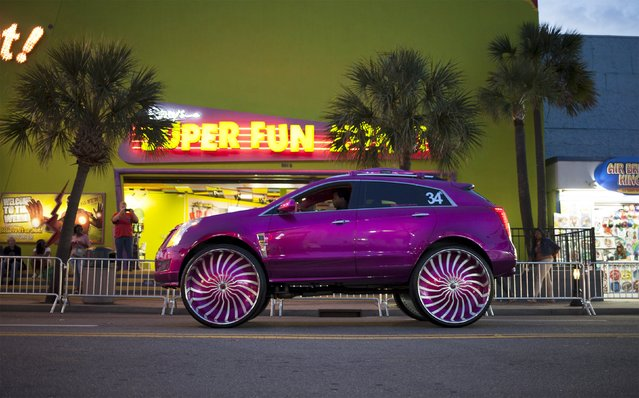 A customized SUV cruises down Ocean Boulevard during the 2015 Atlantic Beach Memorial Day BikeFest in Myrtle Beach, South Carolina May 22, 2015. (Photo by Randall Hill/Reuters)