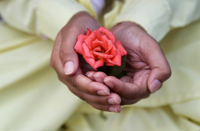 A Muslim boy holds a rose after offering Eid al-Fitr prayers marking the end of the holy fasting month Ramadan in Mumbai, June 5, 2019. (Photo by Francis Mascarenhas/Reuters)