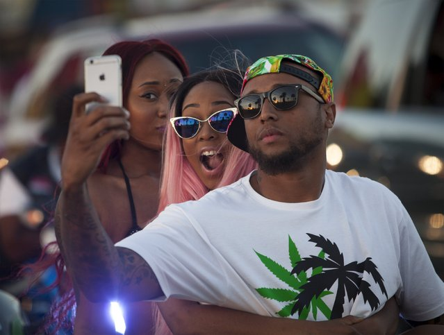 Festival goers take a group selfie while waiting in traffic on Ocean Boulevard during the 2015 Atlantic Beach Memorial Day BikeFest in Myrtle Beach, South Carolina May 24, 2015. (Photo by Randall Hill/Reuters)