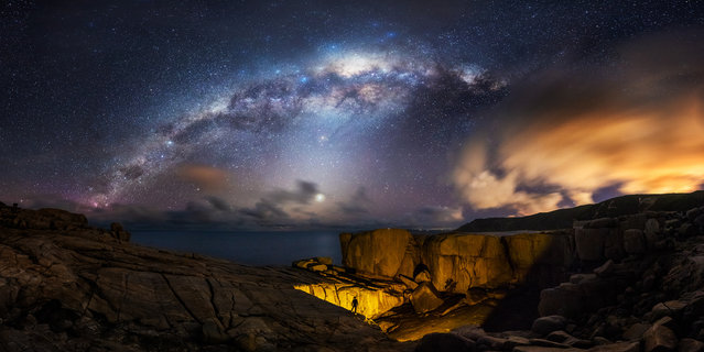 Albany Milkyway. Bai Yifan (China). Each year in September and October the Milky Way is at its best position. The galactic core is right in the middle of the sky. The photographer stood on the cliff by the sea and with his torch he lit up the natural bridge to make it look like a giant hole. The bridge was created by the gradual wearing away of the granite rock by the great Southern ocean. This is a panoramic image of 25 single exposures combined. (Photo by Bai Yifan/National Maritime Museum)