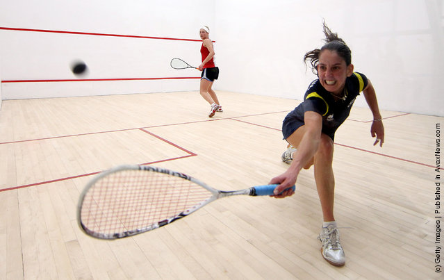 Thaisa Serafini of Brasil (R) plays a backhand during her Squash match against Lily Lorentzen of the USA during Day One of the XVI Pan American Games