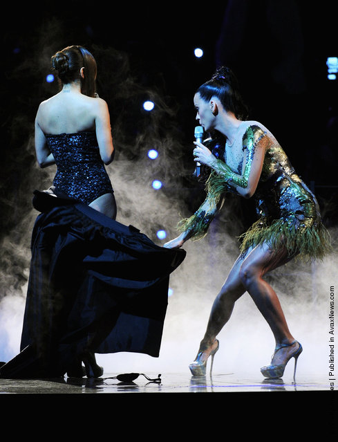 Katy Perry and host Eva Longoria Parker perform onstage during the MTV Europe Music Awards 2010 live show at La Caja Magica on November 7, 2010 in Madrid, Spain