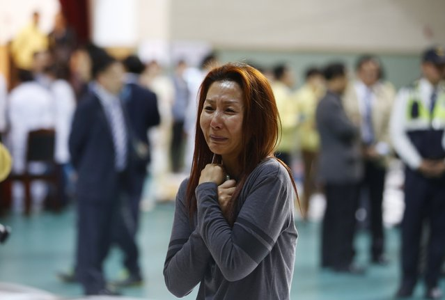 The mother of a passenger who was on a sinking ferry reacts as she finds her son at a gym where rescued passengers gather in Jindo April 16, 2014. (Photo by Kim Hong-Ji/Reuters)