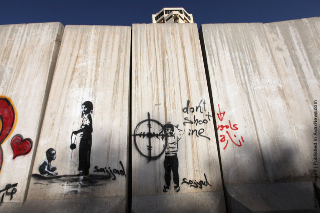 Graffiti is seen on a protective blast wall in Baghdad, Iraq