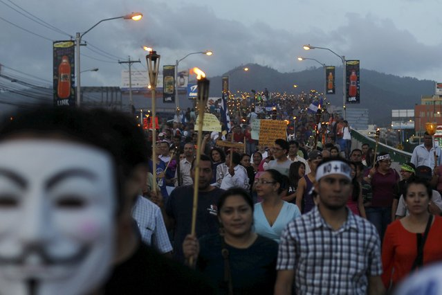 People take part in a march to demand the resignation of Honduras' President Juan Hernandez in Tegucigalpa July 3, 2015. Tens of thousands Hondurans poured onto the streets of the capital Tegucigalpa on Friday to demand the resignation of President Juan Orlando Hernandez in the biggest demonstration yet against the country's leader over allegations of corruption. (Photo by Jorge Cabrera/Reuters)