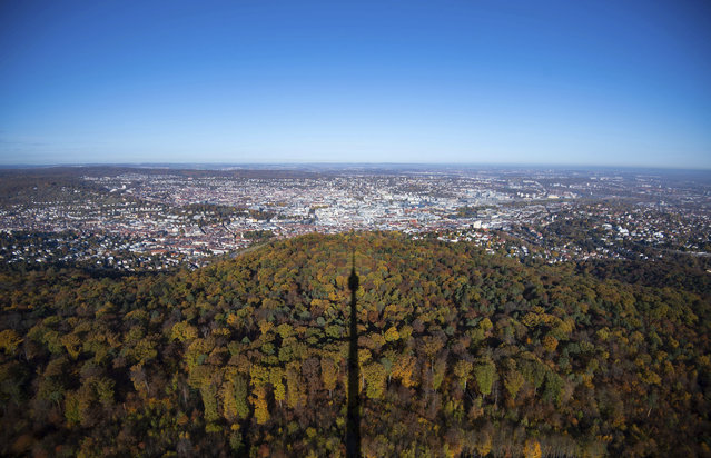 The TV tower casts a shadow on the autumnal colored forest in Stuttgart, southern Germany, Wednesday, November 11, 2018. (Photo by Marijan Murat/DPA via AP Photo)