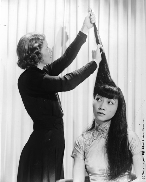 1930: American-Chinese actress Anna May Wong (1907 - 1961) having her hair done