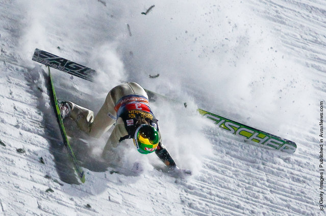 Tom Hilde of Norway crashes during the FIS Ski Jumping World Cup Vierschanzentournee
