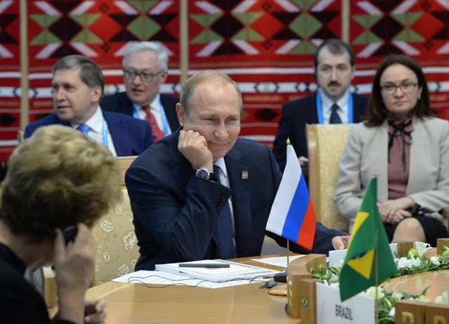 Brazil's President Dilma Rousseff, left, and President of Russia Vladimir Putin, center, attend BRICS (Brazil, Russia, India, China, South Africa) summit in Ufa, Thursday, July 9, 2015. Russia's Central Bank chairwoman Elvira Nabiullina sits at right. (Photo by Host photo agency/RIA Novosti Pool Photo via AP Photo)