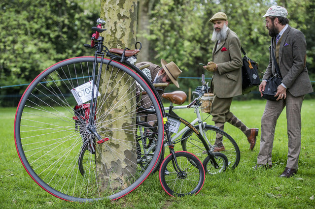 Participants gathers at the start of the The Tweed Run in central London, Britain, May 14, 2016. The Tweed Run, a very British public bicycle ride through London's streets, with a prerequisite that participants are dressed in their best tweed cycling attire. Now in it's 8th year the ride follows a circular route from Clerkenwell via the Albert Memorial, Buckinham Palace and Westminster. (Photo by Guy Bell/Rex Features/Shutterstock)