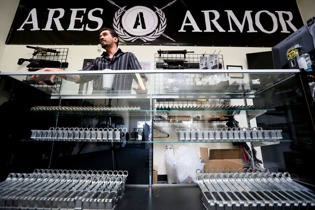 "Karras stands behind a counter with lower receivers for sale at Ares Armor in Oceanside, Calif. ""In the current day and age we live in, the NSA receives files on almost everyone in our country"", Karras said. ""This is a way for people to maintain their privacy"". (Photo by Sandy Huffaker for The Washington Post)"