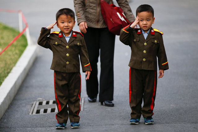 Boys wearing military uniforms salute as they are photographed in a zoo in Pyongyang, North Korea April 16, 2017. (Photo by Damir Sagolj/Reuters)
