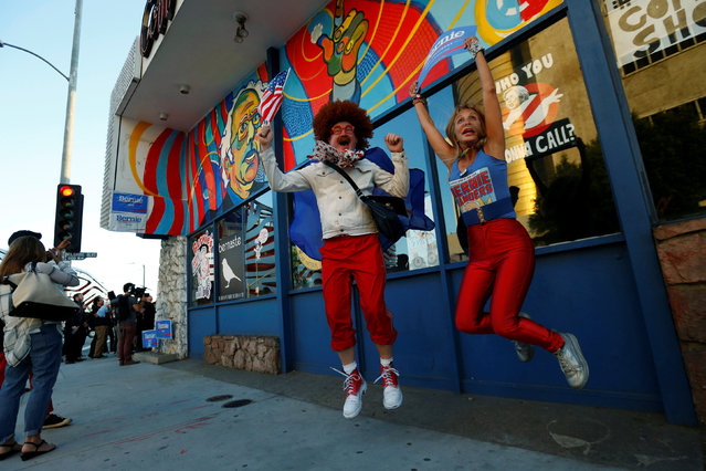 Supporters Rereduce (L) and June Coldwell jump outside Johnie's Coffee Shop, which has been closed since 2000, during a one night only re-opening for a rally in favor of Democratic U.S. presidential candidate Bernie Sanders in Los Angeles, U.S., May 26, 2016. (Photo by Mario Anzuoni/Reuters)