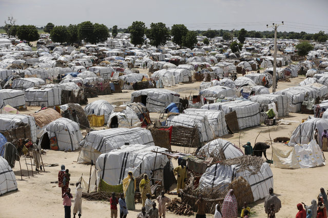 This Sunday August 28, 2016 file photo shows a general view of one of the biggest camp for people displaced by Islamist Extremist in Maiduguri, Nigeria. Camps for thousands of people displaced by Boko Haram will have to stay open beyond the end of this month as Nigeria's military continues to fight the extremists in so-called liberated areas, officials say. The governor of the northern state of Borno, Kashim Shettima, told reporters on Tuesday, May 16, 2017 that it is not yet safe to return people to their homes in many places across the region. (Photo by Sunday Alamba/AP Photo)