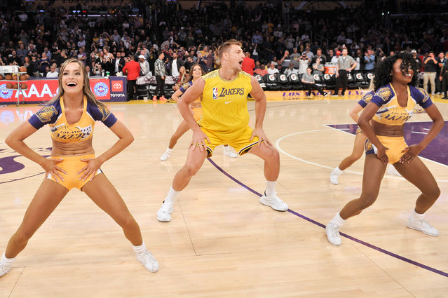 Rob Gronkowski dances with the Laker Girls during halftime at a basketball game between the Los Angeles Lakers and the Oklahoma City Thunder at Staples Center on November 19, 2019 in Los Angeles, California. (Photo by Allen Berezovsky/Getty Images)