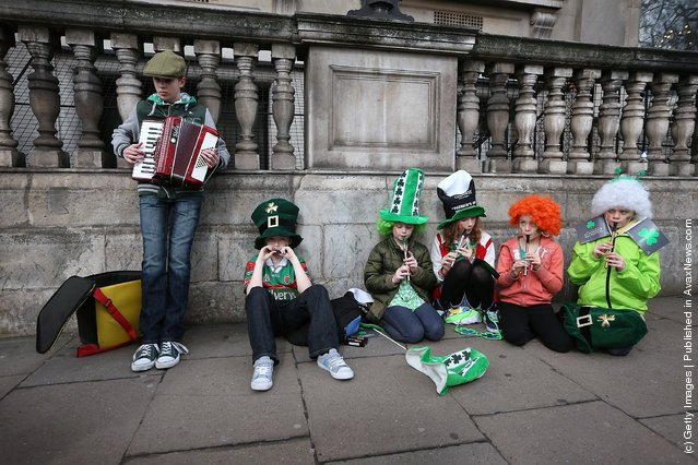 Members the Tir na Nog music group practice before taking part in a St Patrick's day parade on March 18, 2012 in London