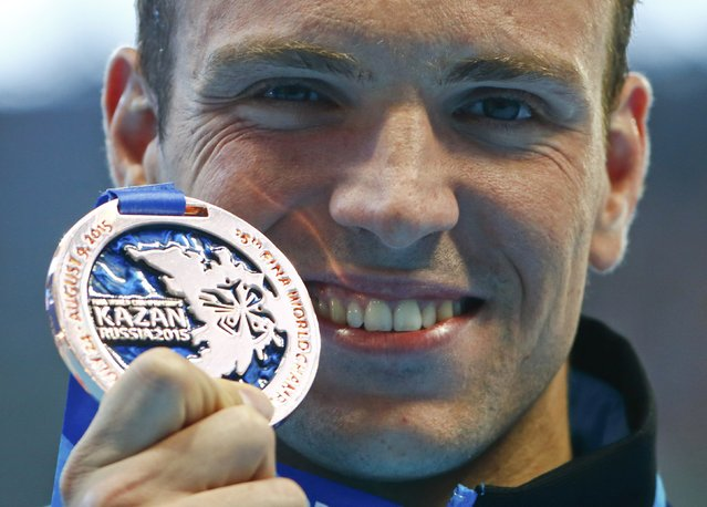 Paul Biedermann of Germany displays his bronze medal after the men's 200m freestyle final at the Aquatics World Championships in Kazan, Russia August 4, 2015. (Photo by Hannibal Hanschke/Reuters)