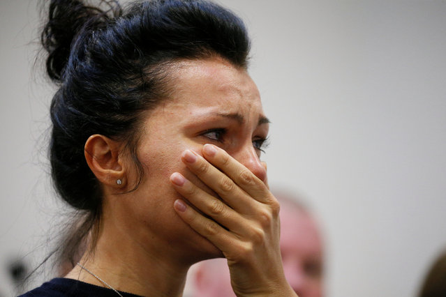 A woman reacts during a news briefing following the crash of the Boeing 737-800 plane, flight PS 752, on the outskirts of Tehran, at the Boryspil International Airport, outside Kiev, Ukraine on January 8, 2020. (Photo by Valentyn Ogirenko/Reuters)