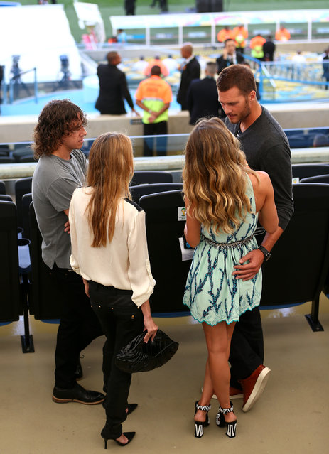 (L-R) Former Spanish international Carles Puyol, Vanessa Lorenzo, model Gisele Bundchen and NFL athlete Tom Brady look on prior to the 2014 FIFA World Cup Brazil Final match between Germany and Argentina at Maracana on July 13, 2014 in Rio de Janeiro, Brazil.  (Photo by Jamie Squire/Getty Images)