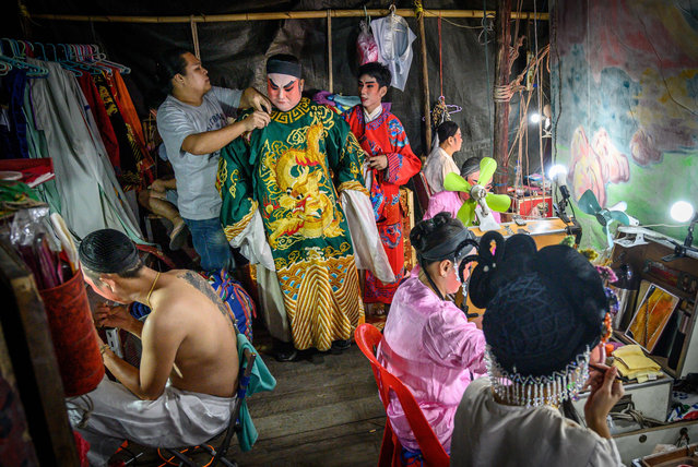 This photograph taken on December 28, 2019 shows actors preparing for a Chinese opera performance by Thailand's Sai Bo Hong troupe on a makeshift stage at a street festival in Bangkok. (Photo by Mladen Antonov/AFP Photo)